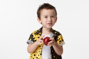 young boy with apple