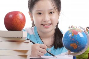 girl learning in classroom