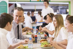 teacher eating with students