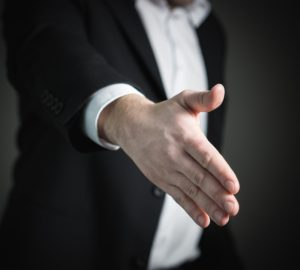 Close-up of extended hand for a handshake