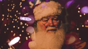Santa surrounded by Christmas lights